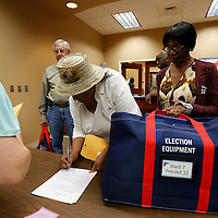 Thomas Wells | BUY at PHOTOS.DJOURNAL.COM<br /> Ophelene Moore, center, and Betty Osborne, right, drop off their completed ballots following Tuesday's vote for continuing the Major Throughfare project into Phase 6.