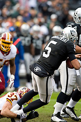 December 13, 2009; Oakland, CA, USA;  Washington Redskins safety Reed Doughty (37) sacks Oakland Raiders quarterback Bruce Gradkowski (5) during the first quarter at Oakland-Alameda County Coliseum.  Washington defeated Oakland 34-13.