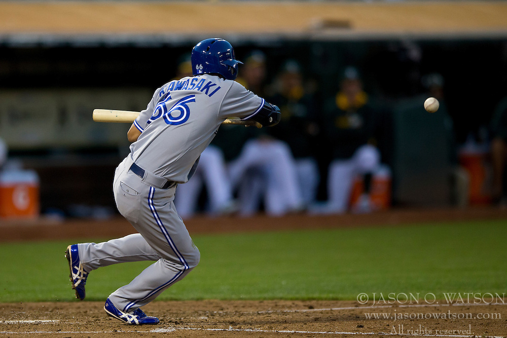 OAKLAND, CA - JULY 05:  Munenori Kawasaki #66 of the Toronto Blue Jays hits a sacrifice bunt against the Oakland Athletics during the fifth inning at O.co Coliseum on July 5, 2014 in Oakland, California. The Oakland Athletics defeated the Toronto Blue Jays 5-1.  (Photo by Jason O. Watson/Getty Images) *** Local Caption *** Munenori Kawasaki