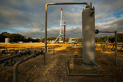 Equipment and pipelines at a petrochemical worksite.