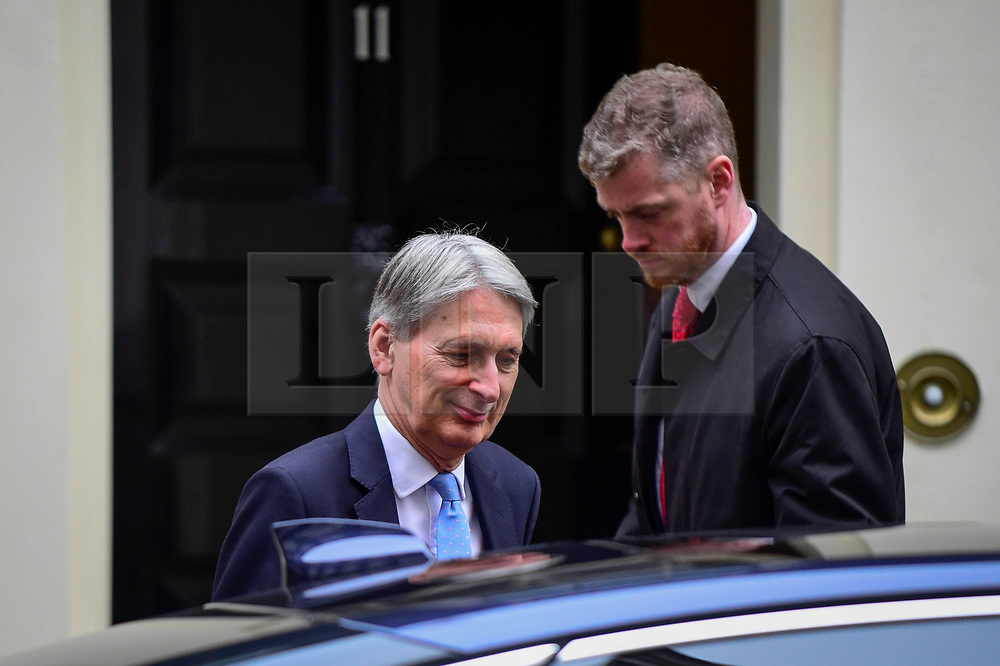 © Licensed to London News Pictures. 04/12/2018. LONDON, UK. Philip Hammond MP, Chancellor of the Exchequer, leaves the weekly Cabinet Meeting at Number 10 Downing Street in London, Britain, on December 4, 2018.  John Bercow, Speaker of the House, has stated that the government may be in contempt of Parliament for declining to release its full legal advice on Britain's exit from the European Union.  This issue is to be debated in the House of Commons after the Cabinet Meeting and will delay the start of MP's debating Theresa May's Brexit agreement with the European Union, ahead of their vote on December 11.  Photo credit: Stephen Chung/LNP