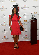 Laila Ali, former boxer and daughter of Muhammad Ali, walks the Kentucky Derby red carpet, Saturday, May 5, 2018, at Churchill Downs in Louisville, Ky.  Longines, the Swiss watch manufacturer known for its luxury timepieces, is the Official Watch and Timekeeper of the 144th annual Kentucky Derby. (Photo by Diane Bondareff/Invision for Longines/AP Images)