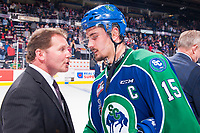 REGINA, SK - MAY 23: Regina Pats' assistant coach Dave Struch shakes hands with Glenn Gawdin #15 of the Swift Current Broncos at the Brandt Centre on May 23, 2018 in Regina, Canada. (Photo by Marissa Baecker/CHL Images)