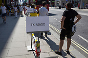 Shoppers queue for the TK Max shop on London's Oxford Street, on the day that UK Prime Minster, Boris Johnson announced in parliament a major easing of Coronavirus pandemic restrictions on July 4th next week, including the re-opening of pubs, restaurants, hotels and hairdressers in England, on 23rd June 2020, in London, England. The three month two metre social distance will be also reduced to one metre plus but in the last 24hrs, a further 171 have died from Covid, bringing the UK total to 42,927.