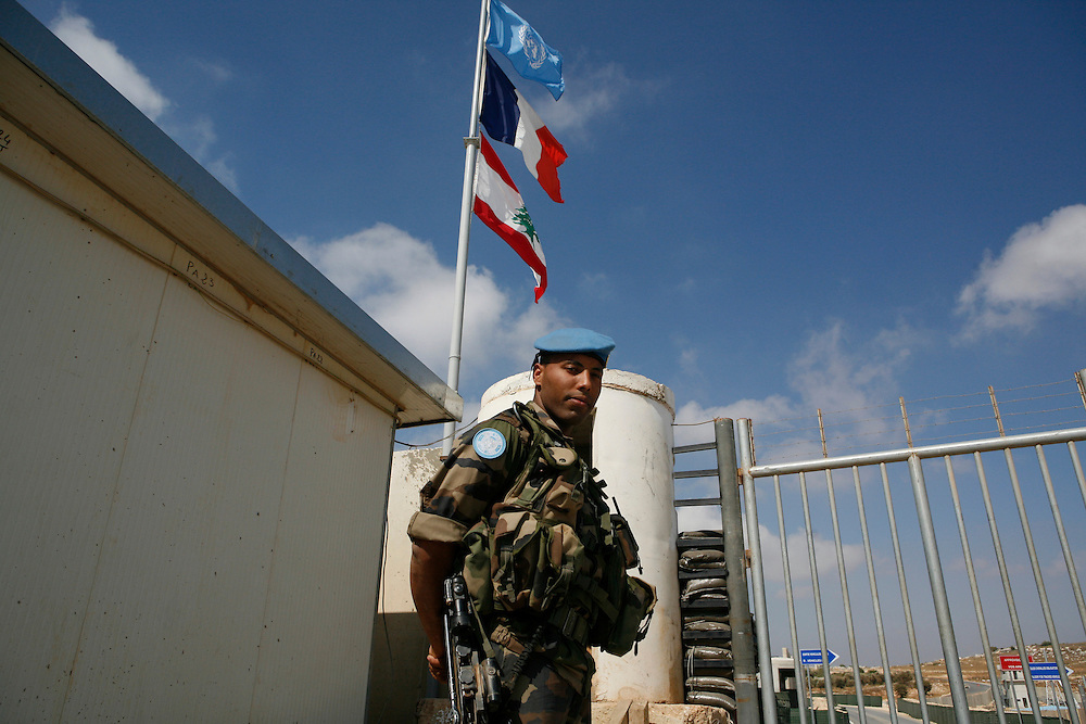 "Originally created in 1978, The United Nations Interim Force in Lebanon (UNIFIL) was created to ensure oversee an Israeli withdrawal from Lebanon, who at that time began its occupation of southern Lebanon that lasted until 2000. After the Israeli war on Lebanon in 2006, UNIFIL enhanced its presence in southern Lebanon to monitor the cessation of hostilities. ..Pictured: A French soldier stands guard at the entrance of the UNIFIL French camp ""2.45"" in al-Tiri in southern Lebanon."