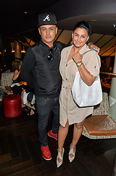 STUART WATTS and KIRAN SHARMA at the launch of Giovanni's Gin Joint at Quaglino's, 16 Bury Street, London on 13th July 2016.