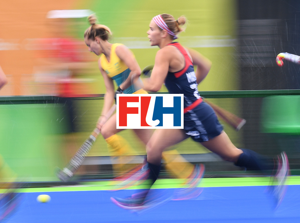 Australia's Georgie Parker (L) and The USA's Alyssa Manley vie for the ball during the womens's field hockey Australia vs USA match of the Rio 2016 Olympics Games at the Olympic Hockey Centre in Rio de Janeiro on August, 8 2016. / AFP / MANAN VATSYAYANA        (Photo credit should read MANAN VATSYAYANA/AFP/Getty Images)