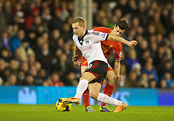 LONDON, ENGLAND - Wednesday, February 12, 2014: Liverpool's Philippe Coutinho Correia in action against Fulham's Lewis Holtby during the Premiership match at Craven Cottage. (Pic by David Rawcliffe/Propaganda)