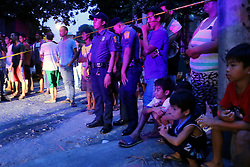 October 8, 2016 - Quezon City, Philippines - Residence of West River Side cor. Senador St. while watching the Members of S.O.C.O. (Scene of the Crime Operatives) process the crime scene and the remain of Notorious top number 1 drug dealer Alias Jessie Hudas with his caliber 45 gun died during a buy bus operation was conducted by Masambong Quezon City Police officers in West River Side cor Senador st. in Delmonte. It's part of the total out war campaign by the government about illegal drugs. (Credit Image: © Gregorio B. Dantes Jr/Pacific Press via ZUMA Wire)