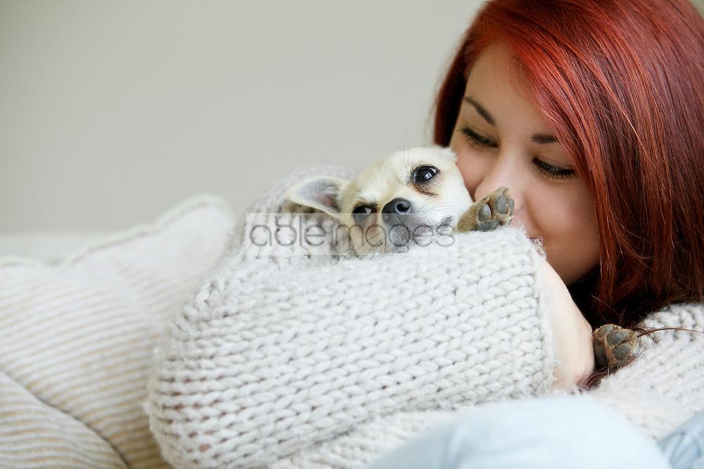 Teenage Girl Hugging a Chihuahua Dog