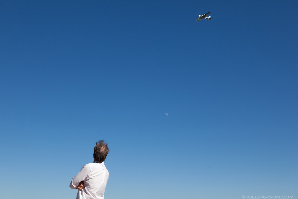 """Spectators in Coronado, CA observe the """"Parade of Flight"""" during the Centennial of Naval Aviation celebration at Naval Air Station North Island, Feb. 12, 2011."""