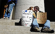 "Amanda Keith, 17, and Mihran Kazandjian, 18, make good on his sign that says ""Make love not war"" during a peace protest at the Ohio Statehouse on March 18, 2006 marking the third anniversary of the war in Iraq."