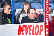 Unai Emery of Arsenal (Manager) takes his place on the Arsenal bench during the Premier League match between Huddersfield Town and Arsenal at the John Smiths Stadium, Huddersfield, England on 9 February 2019.