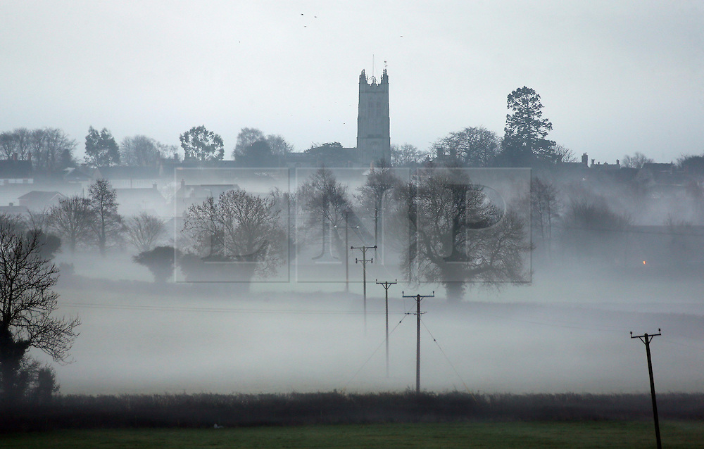 © Licensed to London News Pictures. 22/01/2014. Somerset, UK St Peters Church in Evercreech, Somerset shrouded in mist this morning 22 January 2014. Photo credit : Jason Bryant/LNP