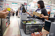cashier at a large supermarket in Japan
