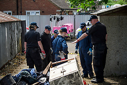 © Licensed to London News Pictures. 16/05/2017. London, UK. Members of a police search team prepare to use digging equipment as the search continues for the body of murdered schoolgirl Danielle Jones at a block of garages in Stifford Clays in Thurrock, Essex. The 15-year-old was last seen on Monday June 18 2001 at about 8am when she left her home in East Tilbury to catch the bus to school.  Photo credit: Ben Cawthra/LNP