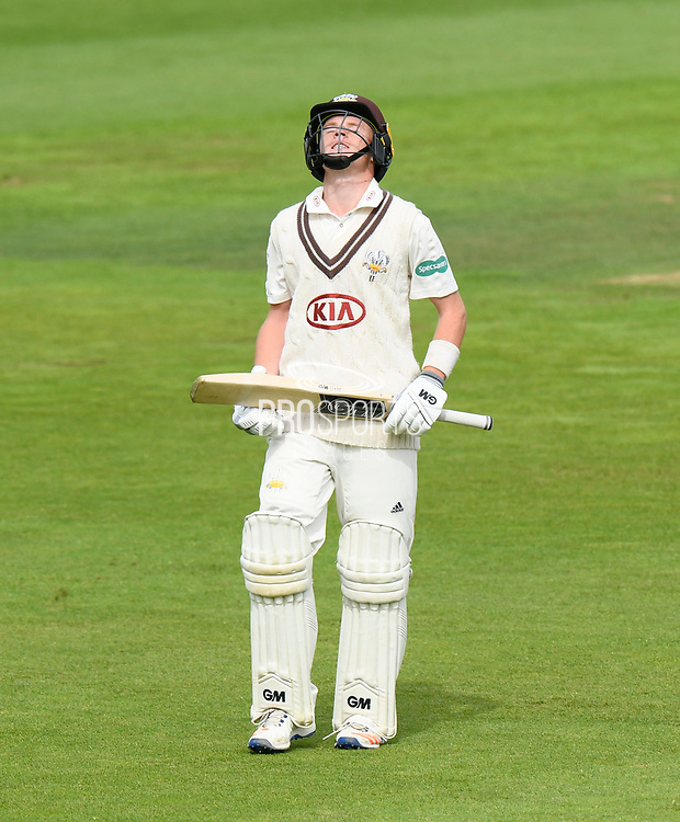 Wicket - Ollie Pope of Surrey looks to the sky as he walks back to the pavilion after being dismissed by Liam Dawson of Hampshire during the Specsavers County Champ Div 1 match between Hampshire County Cricket Club and Surrey County Cricket Club at the Ageas Bowl, Southampton, United Kingdom on 6 September 2017. Photo by Graham Hunt.