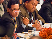"""29 MAY 2015 - BANGKOK, THAILAND: HTIN LYNN, Special Representative of the Myanmar Ministry of Foreign Affairs, addresses the """"Special Meeting on Irregular Migration in the Indian Ocean."""" Myanmar opposes efforts by others to label the Rohingya, an ethnic minority from Myanmar, as an oppressed minority. Myanmar insists the Rohingya, who are overwhelmingly Muslim, are undocumented immigrants and is trying to expel them from Myanmar. Thailand organized and hosted the meeting at the Anantara Siam Hotel in Bangkok. The meeting brought together representatives from the 5 countries impacted by the boat people exodus: Thailand, Malaysia and Indonesia, which have all received boat people, and Myanmar (Burma) and Bangladesh, where they are coming from. Non-governmental organizations, like the International Organization for Migration (IOM) and UN High Commissioner for Refugees (UNHCR) as well as countries responding to the crisis, like the United States, also attended the meeting. A total of 22 organizations attended the one day conference.      PHOTO BY JACK KURTZ"""