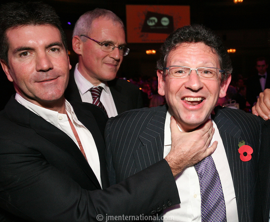 Left to Right Simon Cowell, Vivendi CEO Jean-Bernard Lévy, Lucian Grainge (MIT Awards recipient and Universal Music Group International Chairman/CEO)