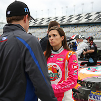 Danica Patrick, driver of the Florida Lottery Chevrolet, speaks to Ricky Stenhouse Jr. after the qualifying practice session of the NASCAR Nationwide Drive4COPD 300 was cut short, at Daytona International Speedway on Friday, February 21, 2014 in Daytona Beach, Florida.  (AP Photo/Alex Menendez)