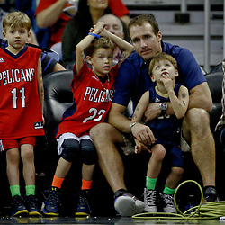 Jan 20, 2017; New Orleans, LA, USA; New Orleans Saints quarterback Drew Brees watches with his sons Bowen Brees and Baylen Brees and Callen Brees during the second half of a game between the New Orleans Pelicans and the Brooklyn Nets at the Smoothie King Center. The Nets defeated the Pelicans 143-114. Mandatory Credit: Derick E. Hingle-USA TODAY Sports