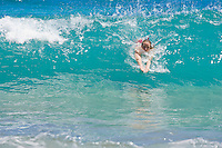 Middle aged woman swimming in the surf at Hamoa Beach, East Maui, Hawaii