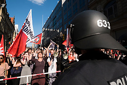 Pro-refugee , pro immigration left wing  demonstrators stage counter protest against far-right demonstrators in Berlin on 7th May 2016.