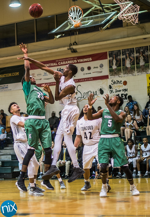 Kannapolis' JD Glenn (23) puts up a shot against Concord during a South Piedmont Conference basketball game Saturday night at Central Cabarrus High School.