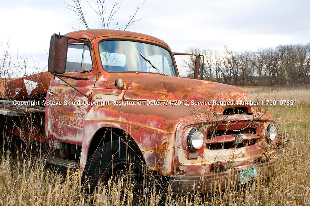 Old rusting forgotten truck stands in farmers field Ottertail Minnesota MN USA