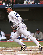New York Yankee Don Mattingly hits a drive to right field against the Kansas City Royals at Kauffman Stadium in Kansas City, Missouri in 1995.