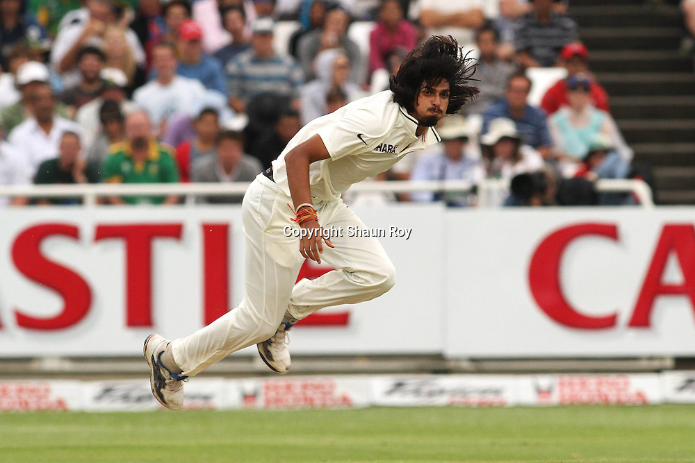 CAPE TOWN, SOUTH AFRICA - 2 January 2011, Ishant Sharma of India follows through during day 1 of the 3rd Castle Test between South Africa and India held at Sahara Park Newlands Stadium in Cape Town, South Africa on the 2 January 2011 .Photo by: Shaun Roy