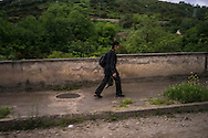A man walks along the street on Sunday, May 8, 2016 in Martakert, Nagorno-Karabakh.