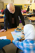 "Vienna. Islamic Gymnasium Vienna(Islamisches Realgymnasium Wien). School director Mr. Sommer with girls wearing ""Hijabs"" (headscarfs)."