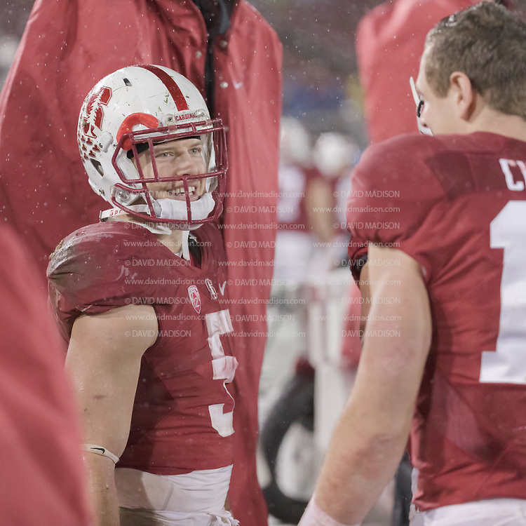 PALO ALTO, CA - NOVEMBER 26:  Christian McCaffrey #5 of the Stanford Cardinal talks with quarterback Keller Chryst #10 on the sidelines during an NCAA football game against the Rice Owls played on November 26, 2016 at Stanford Stadium in Palo Alto, California.  (Photo by David Madison/Getty Images)