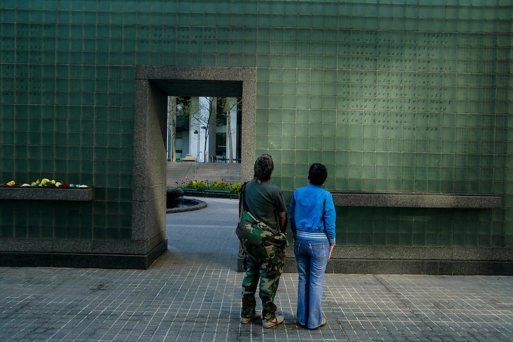 People looking at New York City Vietnam Veterans Memorial Plaza