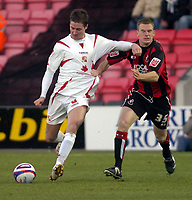 Photo: Matt Bright/Sportsbeat Images.<br /> AFC Bournemouth v Swindon Town. Coca Cola League 1. 29/12/2007.<br /> Barry Corr of Swindon holds off Alex Pearce of Bournemouth to score the opener