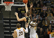 February 27 2013: Iowa Hawkeyes center Gabriel Olaseni (0) tries to block a shot by Purdue Boilermakers guard/forward D.J. Byrd (21) as Iowa Hawkeyes guard/forward Eric May (25) looks on during the first half of the NCAA basketball game between the Purdue Boilermakers and the Iowa Hawkeyes at Carver-Hawkeye Arena in Iowa City, Iowa on Wednesday, February 27 2013.