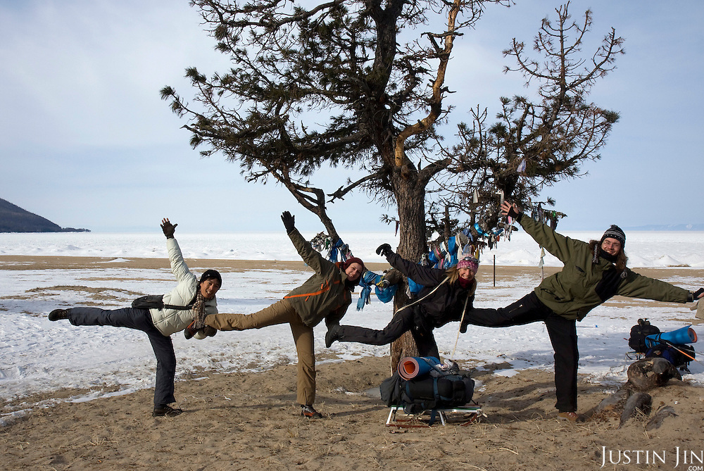 (Left to Right) Justin, Nastya, Heleen, Misha takes a group photo on the bank of frozen Lake Baikal in Siberia, Russia, before they set off for a trek across the lake. .They are a group of five people: Justin Jin (Chinese-British), Heleen van Geest (Dutch), Nastya and Misha Martynov (Russian) and their Russian guide Arkady. .They pulled their sledges 80 km across the world's deepest lake, taking a break on Olkhon Island. They slept two nights on the ice in -15c. .Baikal, the world's largest lake by volume, contains one-fifth of the earth's fresh water and plunges to a depth of 1,637 metres..The lake is frozen from November to April, allowing people to cross by cars and lorries.