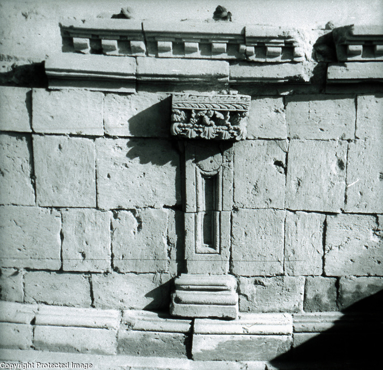 Engaged pilaster on base of fire altar. <br />