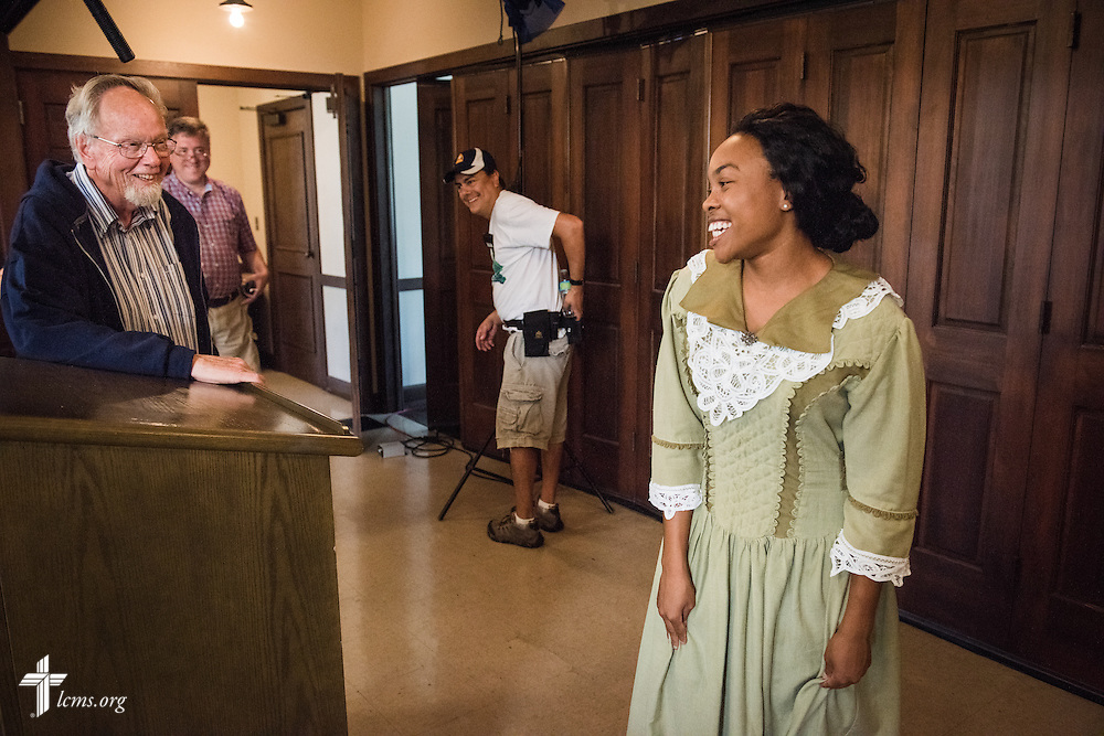 Director Dr. Ardon Albrecht congratulates actress Jasmine Gatewood, performing the role as young Rosa Young, at her wrap during the final day of filming for 'The First Rosa' documentary on Thursday, September 25, 2014, at Concordia College Alabama in Selma, Ala. LCMS Communications/Erik M. Lunsford