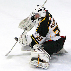 AURORA, ON - Jan 11 : Ontario Junior Hockey League Game Action between the Lindsay Muskies and the Aurora Tigers, Andrew Munroe #33 of the Aurora Tigers Hockey Club makes the save.<br /> (Photo by Brian Watts / OJHL Images)