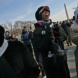 KYLE GREEN | The Roanoke Times<br /> January 20, 2009 With the Washington Monument as a backdrop, (left to right), Nicole White, from Texas, Nancie Ratliffe, from Virginia, and Carrie Mathews, from Texas, scream as Barack Obama is sworn in as the 44th President of the United States.