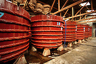 "Besides fishing, fish sauce – a popular form of seasoning in SE Asian food, is an important source of income in Vietnam, especially Phu Quoc and Phan Thiet - makers of ""the good stuff"".  Giant vats of fish sauce, such as these, are used for fermentation before bottling."