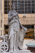 Original 1930 granite statue of Industry by Alvin Meyer outside the Chicago Board of Trade building Chicago, IL.