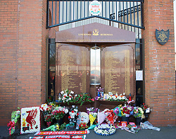 LIVERPOOL, ENGLAND - Saturday, April 11, 2009: Liverpool supporters leave flowers as they pay their respects at the memorial to the 96 supporters who lost their lives at the Hillsborough Stadium Disaster on 15th April 1989. Twenty years on the victims families are still waiting for justice as none of the police officers responsible for the deaths of so many supoporters have ever been brought to justice. (Photo by: David Rawcliffe/Propaganda)