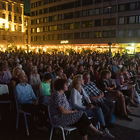 People watch classic western movie Once Upon a Time in the West during an open air screening at a film festival held in front of Budapest's main church in Budapest, Hungary on Sept. 6, 2018. ATTILA VOLGYI