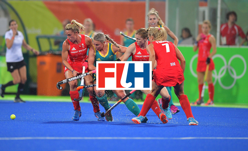 Britain's Crista Cullen (L) chases the ball with Australia's Mariah Williams (2L) during the women's field hockey Britain vs Australia match of the Rio 2016 Olympics Games at the Olympic Hockey Centre in Rio de Janeiro on August, 6 2016. / AFP / Carl DE SOUZA        (Photo credit should read CARL DE SOUZA/AFP/Getty Images)