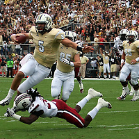 UCF Knights quarterback Blake Bortles (5) leaps over South Carolina Gamecocks safety Kadetrix Marcus (25) during an NCAA football game between the South Carolina Gamecocks and the Central Florida Knights at Bright House Networks Stadium on Saturday, September 28, 2013 in Orlando, Florida. (AP Photo/Alex Menendez)