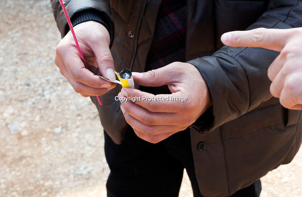 Hunan, Liuyang, Dec. 19..2013 : a manager shows how a firecracker is is build. There's differences between the Chinese and the foreign market.