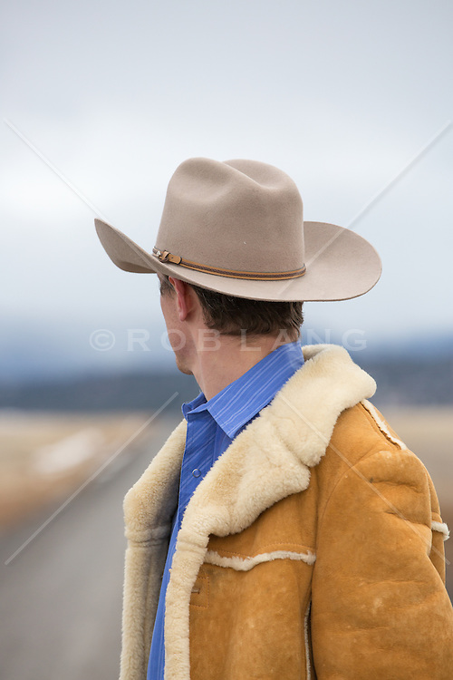 cowboy looking down a dirt road